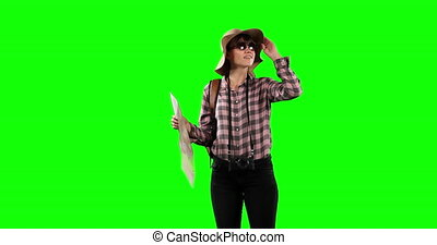 Front view of a tourist Caucasian woman with green screen