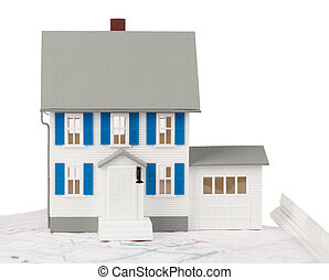Front view of a toy house model on a ground floor plan...