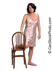 front view of a woman playing with a chair with nightgown  on white background,