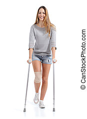 Front view of a woman walking with crutches isolated on a white background