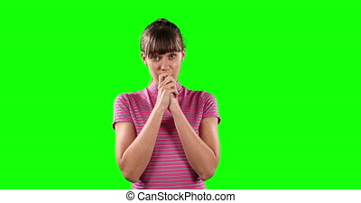 Front view of an incomprehensible Caucasian woman with green screen