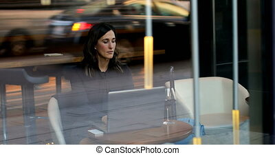 Front view of beautiful caucasian businesswoman working on laptop in a modern hotel 4k