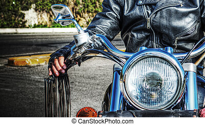 front view of  biker and motorcycle in hdr