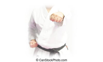 Front view of black belt punching with both hands - Closeup...