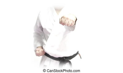 Front view of black belt punching with both hands