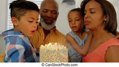 Front view of black family celebrating birthday in kitchen of comfortable home 4k