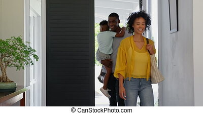 Front view of black family entering in the house 4k