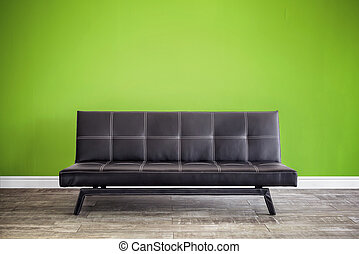 Front view of black leather sofa.
