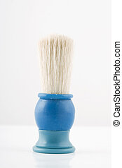 front view of blue shaving brush on white background