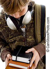 front view of boy with books and headphone