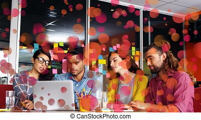 Front view of business people discussing and working together on a computer
