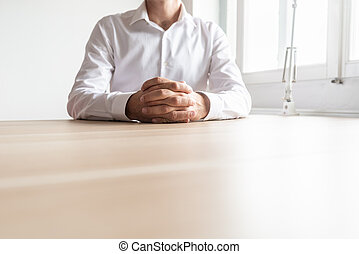 Front view of businessman sitting at his office desk