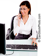 front view of businesswoman busy on phone with white...