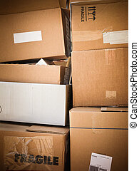 front view of cardboard boxes heap