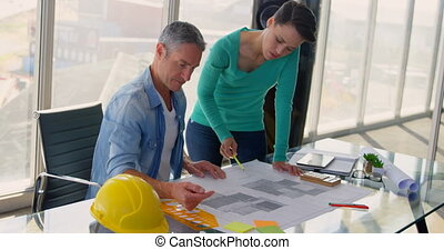 Front view of Caucasian Business people discussing over blueprint in the office 4k