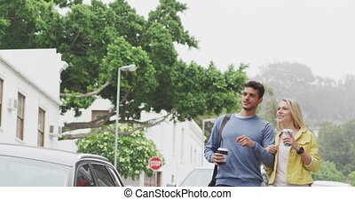 Front view of Caucasian couple on the go during coronavirus pandemic