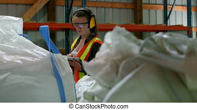 Front view of caucasian female worker working on digital ...