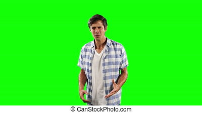 Front view of Caucasian man confusing with green screen - ...
