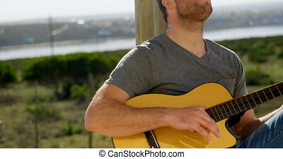 Front view of caucasian man singing and playing guitar with eyes closed 4k