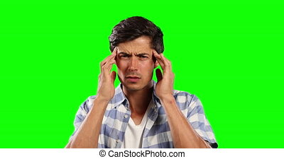 Front view of Caucasian man with headache and green screen...