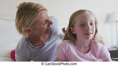 Front view of Caucasian woman cuddling her daughter - Happy ...