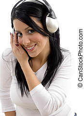 front view of cheerful woman listening music