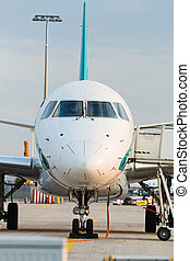 Front view of commercial jet plane on the runway.