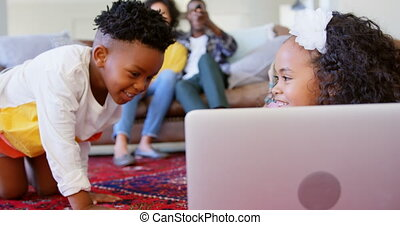 Front view of cute black kids having fun in living room at comfortable home 4k