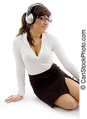 front view of female accountant listening music with headphones
