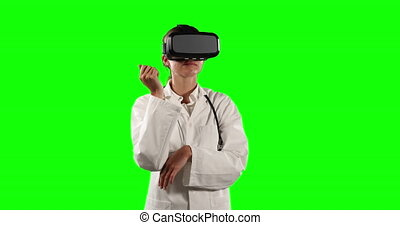 Front view of female doctor using virtual reality with green...
