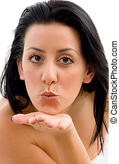 front view of female giving flying kiss in spa - front view...