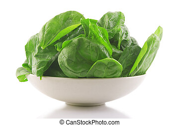 fresh spinach in a white bowl - front view of fresh spinach...