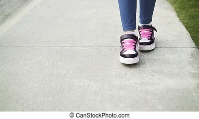 Front view of girl s legs roller skating