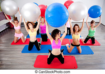 group of people doing pilates in a gym