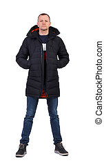 4834223231d Handsome stylish man in a black baseball cap and winter jacket ...