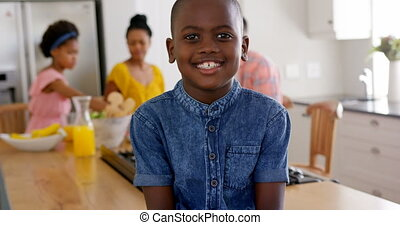 Front view of happy black boy looking at camera in a comfortable home 4k