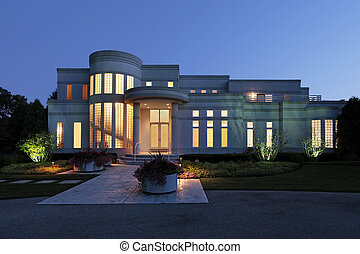 Front view of luxury home at dusk