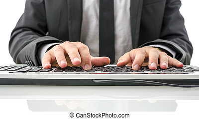 Front view of insurance agent typing on computer on his white office desk.