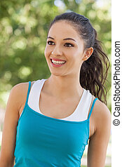 Front view of joyful young woman wearing sportswear in a ...
