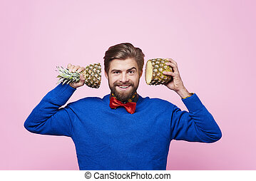 Front view of man  posing with fruit