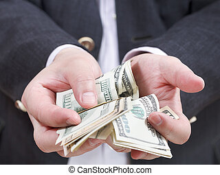 front view of many dollar banknotes in male hands
