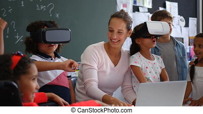 Front view of Mixed-race schoolkids using virtual reality ...