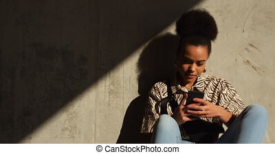 Front view of mixed race woman on smartphone - Front view of...