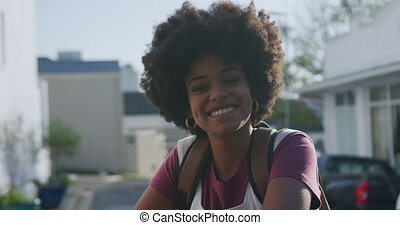 Front view of mixed race woman smiling - Front view of happy...