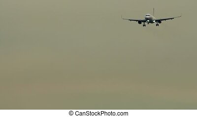Front view of plane with landing gear down - Approaching to...