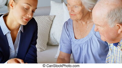 Front view of senior Caucasian couple meeting with real estate agent in a comfortable home 4k