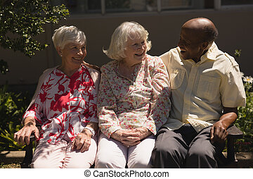Front view of senior friends interacting with each other in ...