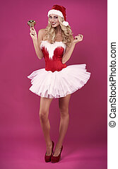 Front view of sexy santa claus with golden bell
