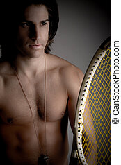 front view of shirtless man holding racket on an isolated...