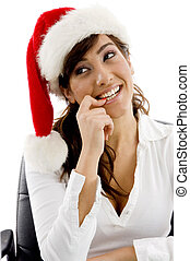 shy female executive wearing christmas hat looking sideways...